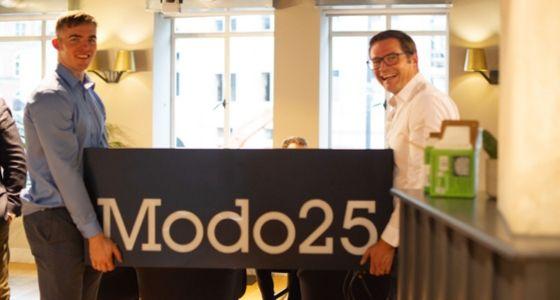 John and John and Modo25 sign