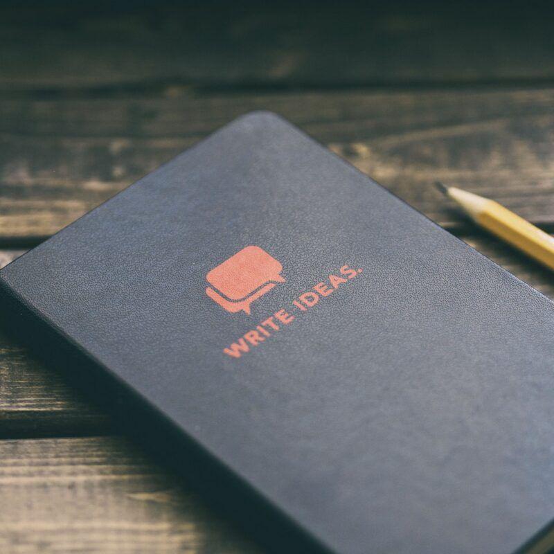 digital marketing buzzwords - black notebook